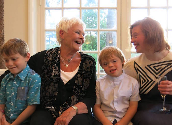 Dame Judi & Sarah laughing with competition winners
